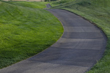 The Rolling Golf Cart Path In The Early Morning Under The Cool Summer Sun.