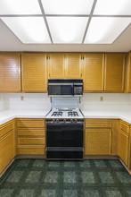 Old Condo Kitchen Vertical View