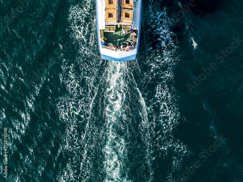 Photo view from above of tourist cruise ship boat deck with passengers