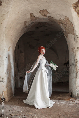 ab24487b250 Young renaissance redhead ghost princess with hairstyle in old castle. Doll  in the corset. Victorian princess in palace. Fabulous rococo ghost in white  ...