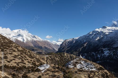 Stampa su Tela A Tibetan Budhist stupa in the impressive valley near Manang along the Annapurna