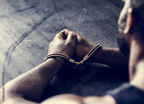 Arrested man with handcuffs on wrists Wallpaper Mural