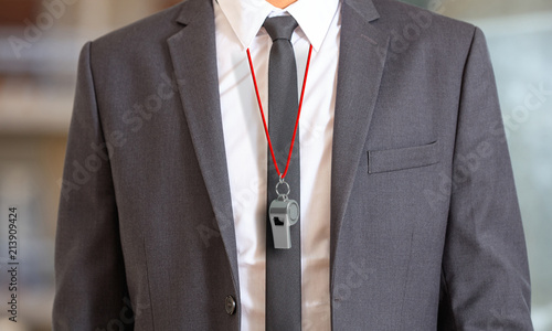 Cuadros en Lienzo  Man in suit wearing a whistle with red string. 3d illustration