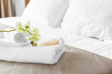 Towels And Flower On Bed In Ho...