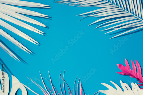 Tropical bright colorful background with exotic painted tropical palm leaves Canvas Print
