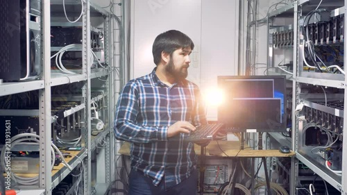 Computer engineer works at a cryptocurrency mining farm.