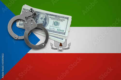 Fotografía  Equatorial Guinea flag  with handcuffs and a bundle of dollars