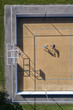 Two people playing basketball, aerial view