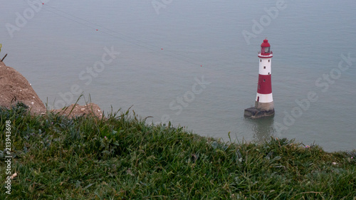 Fotografie, Obraz  Lighthouse at Seven sisters in Sussex England