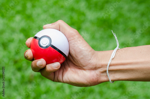 Valokuva  Bangkok, THAILAND - 5 September 2016: Pokeball toy in hand
