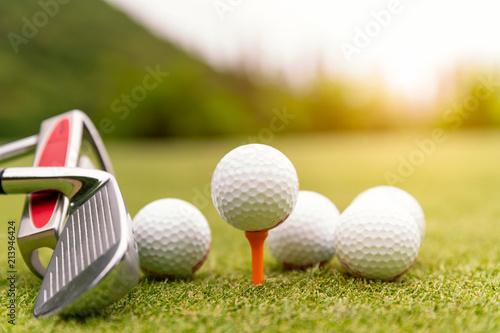 Poster Golf Golf balls and golf club on green grass