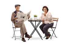 Elderly Man Reading A Newspape...