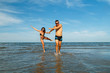 young couple in love have fun on the beach