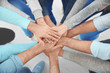 People putting hands together, closeup. Group therapy