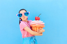Funny Party Girl With Big Sunglasses And Huge Cupcake