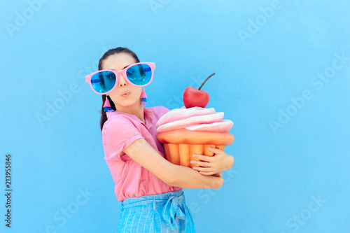 Fotografie, Obraz Funny Party Girl with Big Sunglasses and Huge Cupcake