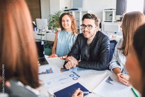 Modern business people talk and smile during a conference in the office