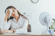 canvas print picture - sweaty businesswoman working in office with electric fan