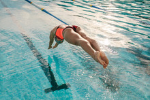 Female Swimmer Diving Into Ind...