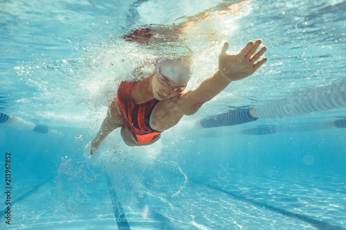 Female athlete swimming in pool Canvas Print