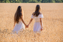 Two Girls Walking Together On ...