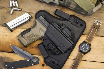 Tactical Handgun and Gear including Watch, Bullets, Knife, Holster, Bag