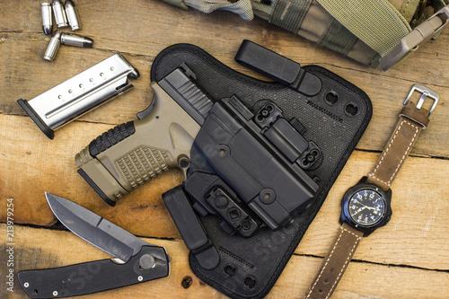 Fotografía Tactical Handgun and Gear including Watch, Bullets, Knife, Holster, Bag