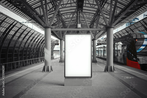 Fotografie, Tablou Blank white banner at metro station with arrived train on a background
