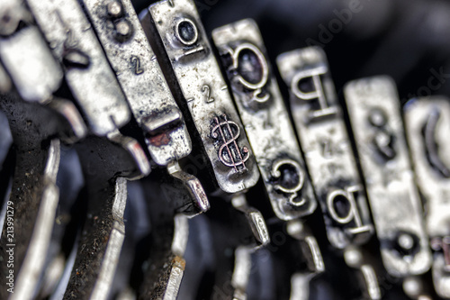 Fotografie, Obraz  Metal element of the writing of a typewriter, highlighting the dollar sign