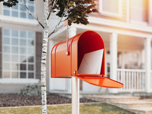 Orange Mail Box With Big House...