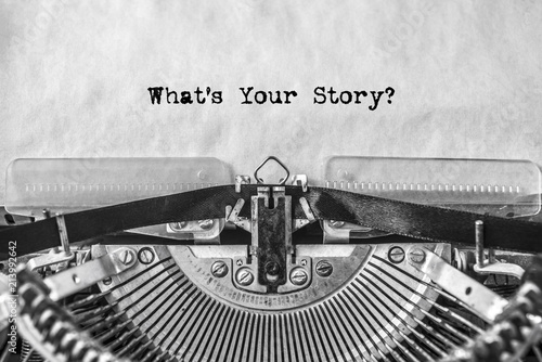What's Your Story? the text is typed on an old typewriter. tell your stories. close-up