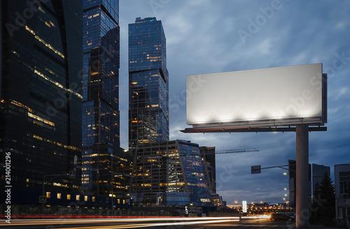 Obraz Blank billboard at twilight next to skyscrapers. 3d rendering - fototapety do salonu