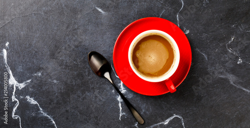 Wall Murals Cafe Coffee in a red cup on the Dark Marble Background.Cappuccino or latte .Copy space for Text. Top View. Flat Lay.