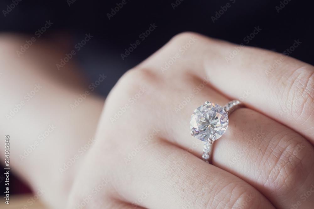 Fototapety, obrazy: engagement diamond ring on woman finger closeup