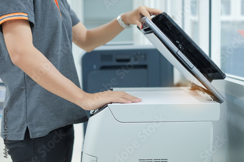 Bussiness woman Hand putting a document paper into printer scanner or laser copy Wallpaper Mural