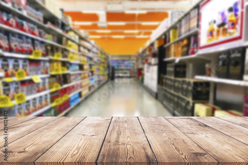 Empty wood table top on shelf in supermarket blurred background