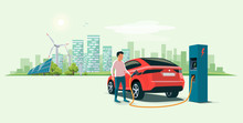 Modern Electric Suv Car Charging At The Charger Station With A Young Man Holding The Cable. Wind Turbines And Solar Panels With Urban Landscape In Background. Flat Vector Illustration Concept.