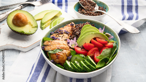 Healthy bowl with roasted chicken and quinoa.