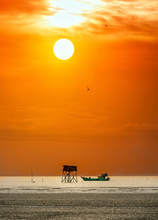 Dawn On The Beach With A Guardhouse Beside The Boat As A Means To Fishermen Seafood Clam Offer For Everyone. It Is Beautiful To See The Sunrise On This Trip