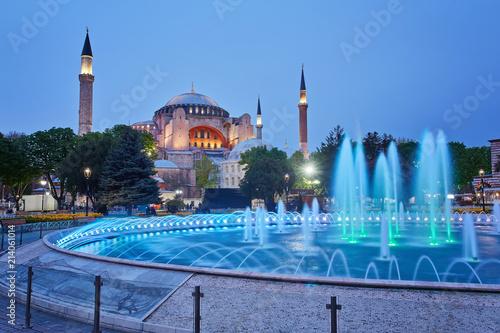 Hagia Sophia basilica in Istanbul, Turkey, with colorful illuminated fountains