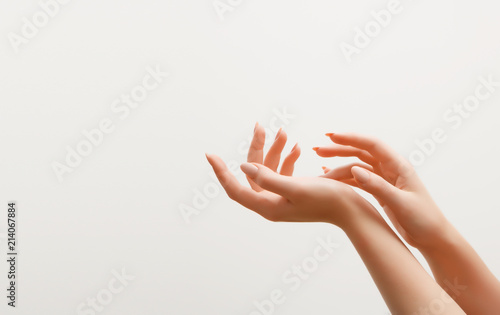 Keuken foto achterwand Manicure Closeup image of beautiful woman's hands with light pink manicure on the nails. Skin care for hands, manicure and beauty treatment. Elegant and graceful hands with slender graceful fingers
