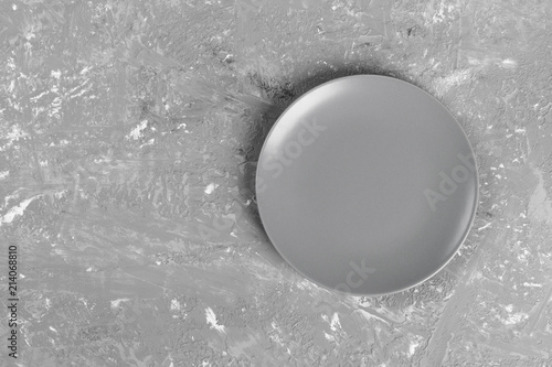 Photo Stands Painterly Inspiration Top view of matte round empty plate on dark background