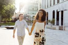 Cheerful Couple Walking On Street