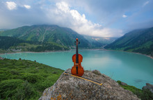 Violin On The Background Of Mountain Lake