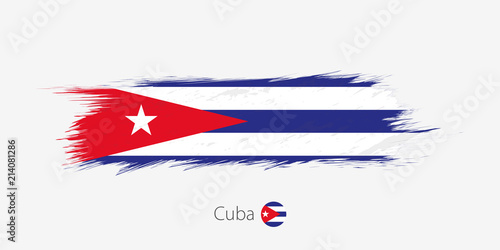 Photo  Flag of Cuba, grunge abstract brush stroke on gray background.