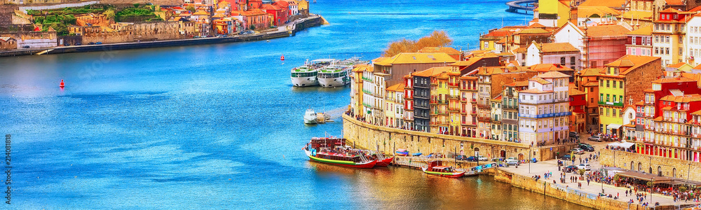 Fototapeta Porto, Portugal old town ribeira aerial promenade view with colorful houses, Douro river and boats, banner panoramic view