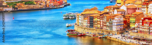 Lieu d Europe Porto, Portugal old town ribeira aerial promenade view with colorful houses, Douro river and boats, banner panoramic view