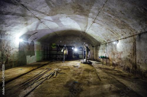 Photo  Large abandoned underground empty warehouse