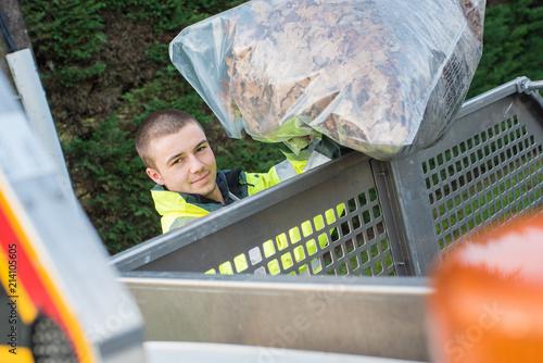 dustman working at outdoor market