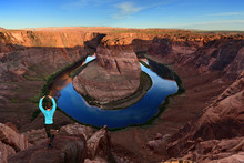 Woman In Yoga Pose By The Horseshoe Bend In Page, Arizona USA